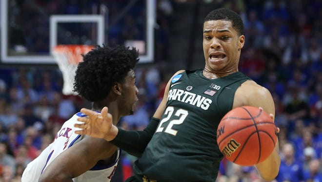 Miles Bridges reacts as Kansas' Josh Jackson defends during the first half in the second round of the NCAA tournament on March 19, 2017.