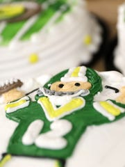 Aaron Rodgers is frosted onto a cake at Simple Simon