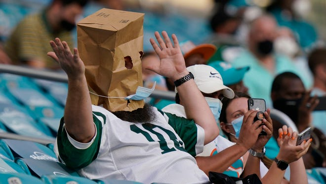 A New York Jets fans reacts to the team performance during the second half of an NFL football game against the Miami Dolphins, Sunday, Oct. 18, 2020, in Miami Gardens, Fla.