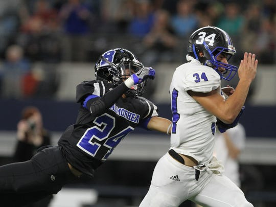 Richland Springs' Traven Day runs for a touchdown as Balmorhea's Josiah Garcia attempts a diving tackle during the second quarter of the UIL Class 1A Division II state championship Wednesday afternoon at AT&T Stadium in Arlington.