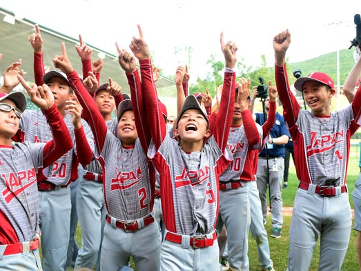 Ryuto Inoue (5) leads the celebration after Japan defeated