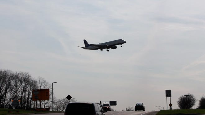 A commercial airplane lands at Greater Rochester International Airport.