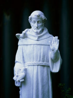 A statue of St. Francis of Assisi , known for his love of animals, at Mission San Francisco de Asis in San Francisco, California.