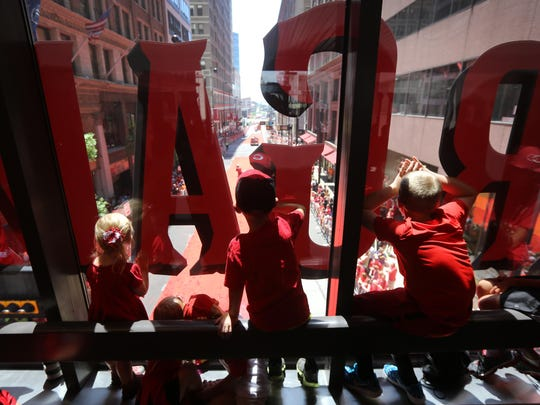 Kids watch the MLB All-Star Red Carpet Show from a Downtown skywalk at Walnut and Fifth Streets Tuesday Downtown before the All-Star Game.