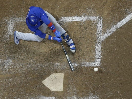 Chicago Cubs' Javier Baez hits an RBI single during the ninth inning of a baseball game against the Milwaukee Brewers Thursday, Sept. 21, 2017, in Milwaukee. (AP Photo/Morry Gash)