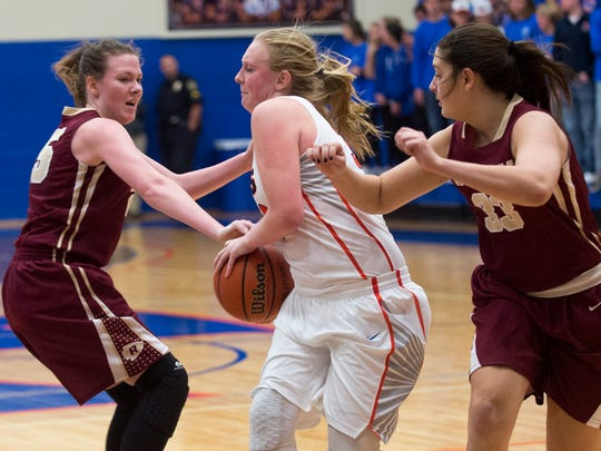 William Blount's Jenna Kallenberg (33) tries to move in between Riverdale's Alexis Whittington (25) and Allison Mayeux (33) during William Blount's home game against Riverdale on Tuesday, Nov. 22, 2016.