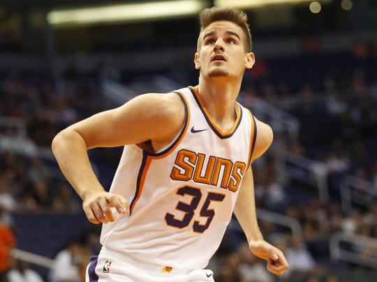 Phoenix Suns forward Dragan Bender (35) looks for a rebound against the Portland Trail Blazers during the first quarter in pre-season NBA action at Talking Stick Resort Arena in Phoenix, Ariz. October 11, 2017.
