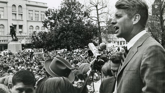 Robert Kennedy is seen speaking at the Marion County Courthouse shortly before he was assassinated. You can see the Grand Theater in the background. The image is part of a show at Willamette Heritage Center at the Mill.