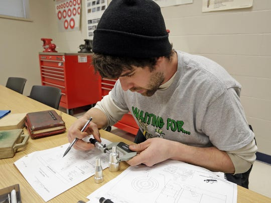 Ethan Wolf of Mazomanie works with a micrometer during