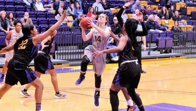 Hardin-Simmons senior guard Danie Mabry drives between a pair of Concordia defenders during the 62-59 loss on Saturday, Jan. 13, 2018 at the Mabee Complex. Mabry scored 20 points to lead the Cowgirls.