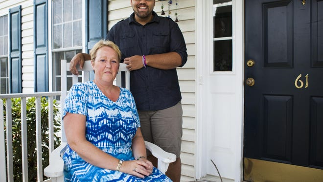 Matt Johnson, who is organizing the MOONFest music festival in Mount Sidney, stands beside his mom, Alex Johnson, at their home in Fishersville on Tuesday, June 9, 2015.