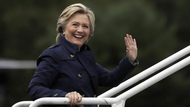 Democratic presidential candidate Hillary Clinton waves as she boards her campaign plane at Westchester County Airport in White Plains, N.Y. on Wednesday.