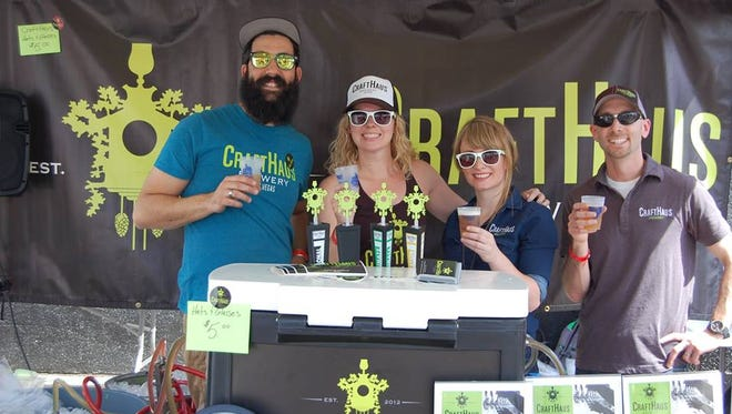 CraftHaus Brewery team representing at a beer festival. From left, founding brewer Steve Brockman, co-owner and founder Wyndee Forrest, founding brewer Steph Cope and co-owner and founder Dave Forrest.