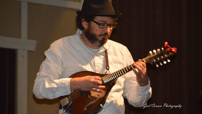 Mickey Abraham playing mandolin at the Will McLean Music Festival.