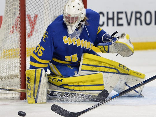 St. Cloud Cathedral goaltender Keegan Karki (35) protects