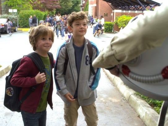 Jacob Tremblayand Noah Jupe appear in a scene from
