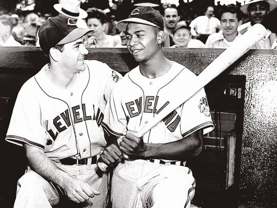 Manager Lou Boudreau and Larry Doby, the first African-American player in the American League, standing in the dugout at Comiskey Park in Chicago on July 5, 1947.