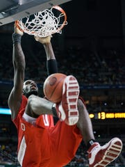 Ohio State center Greg Oden (20) stuff's the ball against