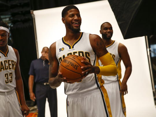 Indiana Pacers forward Paul George (13) shares a laugh with other teammates as Indiana Pacers guard Jeff Teague (44) takes the floor during media day at Bankers Life Fieldhouse on Sept. 25, 2016.