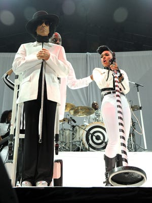 Prince performs with Janelle Monae at the Mohegan Sun Arena on Dec. 29, 2013, in Uncasville, Conn.