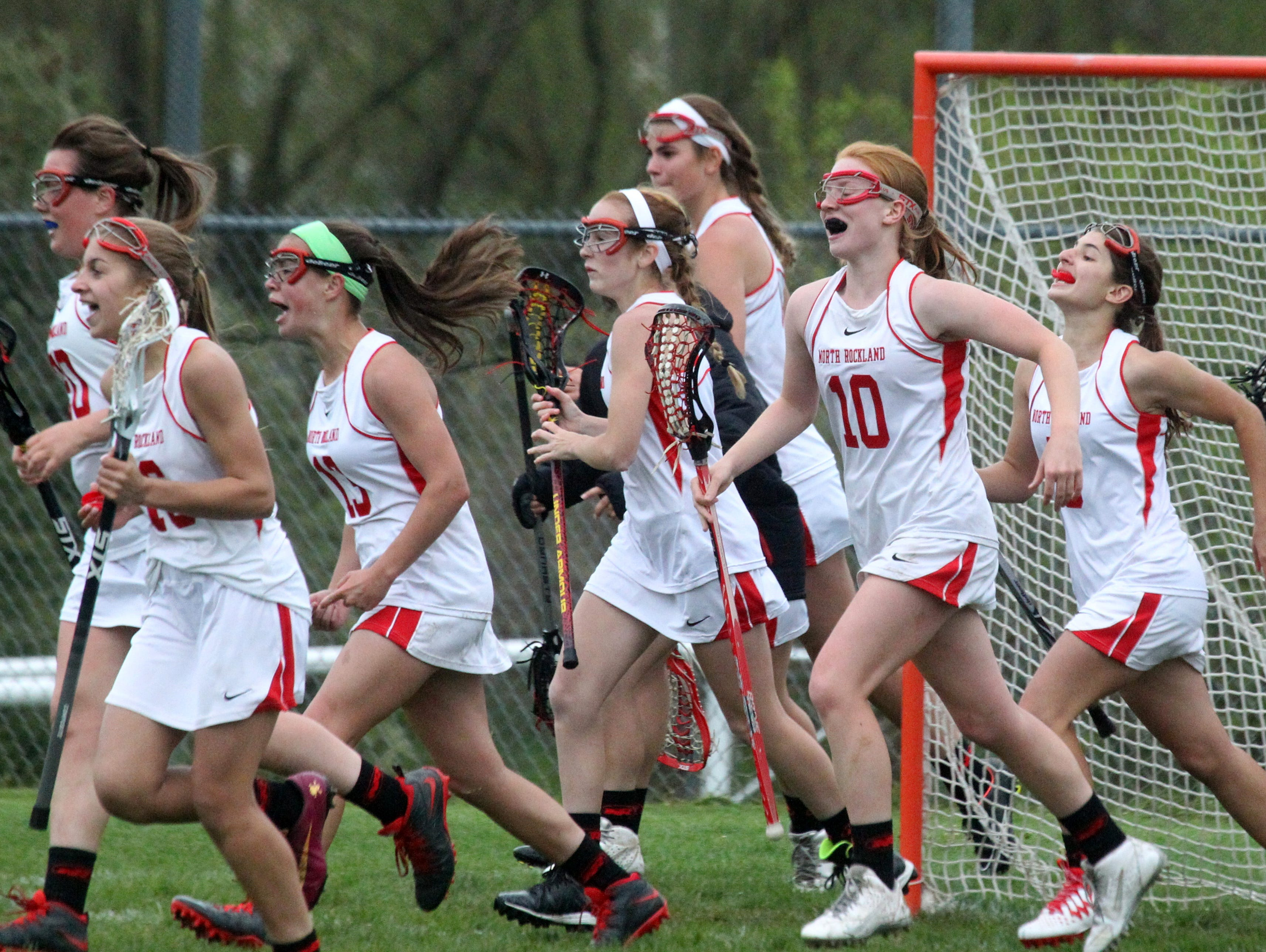 North Rockland celebrates their 8-7 win over Suffern May 4, 2016.