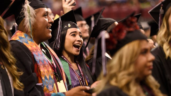 New Mexico State University graduates celebrate at the end of the 2017 Spring Commencement at the Pan American Center. (