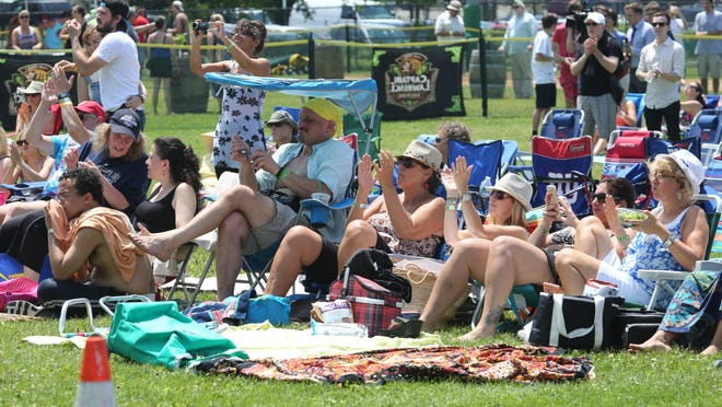 Spectators applaud the band Wild Planes on the Main Stage, during the 11th annual Pleasantville Music Festival 2015, July 11, 2015.