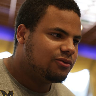 Michigan offensive tackle Grant Newsome talks to reporters