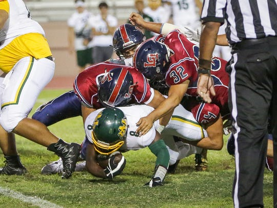 Kavon Fulgham stopped behind the line of scrimmage. The La Quinta varsity football team won Friday's home non-conference game against Notre Dame (Riverside, CA) by a score of 28-10.