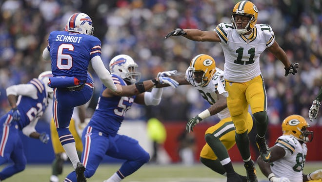 Green Bay Packers' Jarrett Boykin (11) tries to block a punt made by Buffalo Bills punter Colton Schmidt (6) in the second quarter during Sunday's game at Ralph Wilson Stadium in Orchard Park, N.Y.