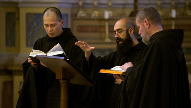 Choirmaster Father Basil Nixen conducts The Monks of Norcia for recording of 'Benedicta' with Father Cassian Folsom, right, and  Brother Ignatius of Indonesia.