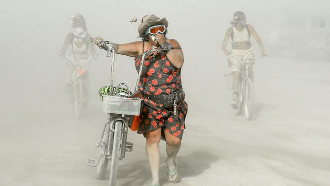 Burners have another day of dust on the playa at Burning Man on the Black Rock Desert of Nevada on Sept. 2, 2015.