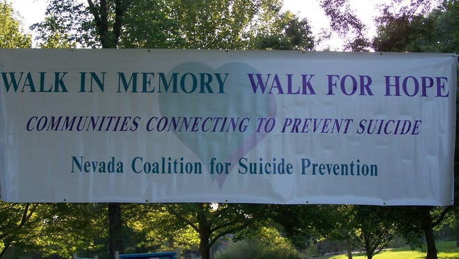"A ""Walk in Memory, Walk for Hope"" banner."