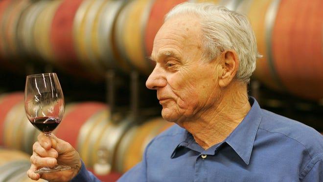 Peter Mondavi samples a glass of Cabernet Sauvignon in 2005. A winery board member said Mondavi died Saturday, Feb. 20, 2016.