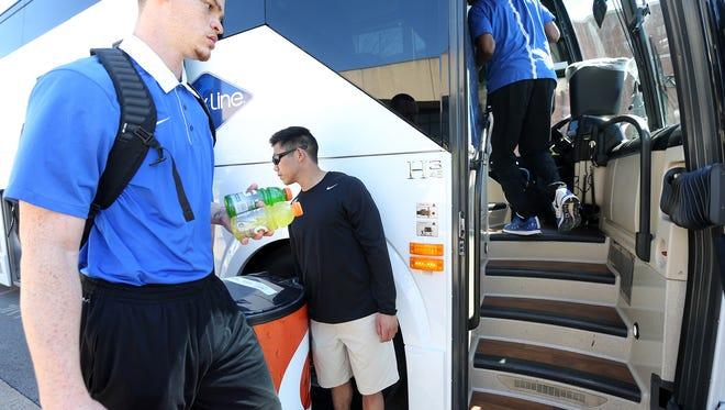 The MTSU's Reggie Upshaw Jr. left gets on the bus , head to the NCAA Tournament, Wednesday March 16, 2016 where MTSU will play Michigan State in St. Louis on Friday, inthe first round of hte NCAA Tournament.