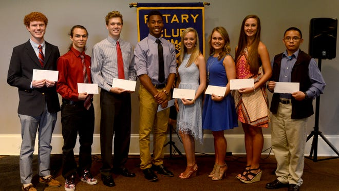 Palmer Bell, Aaron Stone, Adam Joyner, Malique Bowen, Lindsey Gateley, Molly Morris, Blaire Taggart, and Elijah Gasmen were presented with $1,000 scholarship checks Wednesday from the Jackson Rotary Club.