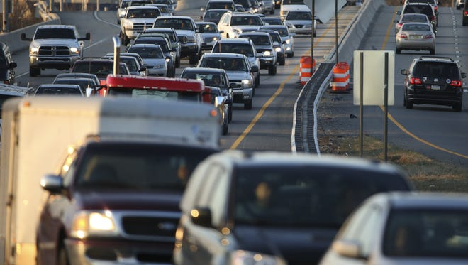 Traffic flows slowly during rush hour on Del. 141 southbound near Interstate 95 on March 8.