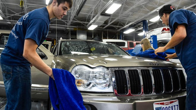 Tri-Rivers students who work in the Automotive Technology department perform safety inspections and wash cars of community members as a part of the Make a Difference Day on Friday/