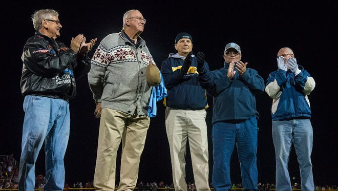 River Valley honored its only state championship squad in the history of the school last week at the Harding-River Valley football game when the 1966 cross country team gathered for its 50th reunion of the title. Coach Duane Kline, second from left, is saluted by some of the members who returned for the honor.