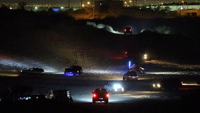 Off-road trucks and ATVs congregate in a desert area just east of the Socorro Student Activities Complex Wednesday night.