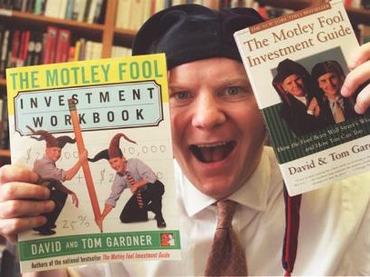 Tom Gardner is shown here with copies of two of the Motley Fool investment books he and his brother, David, have produced.