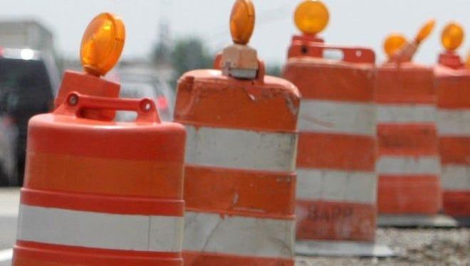 Construction barrels along an expressway.
