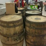 Franklin County sheriff lines up recovered bourbon in thefts from Wild Turkey and Buffalo Trace distilleries.