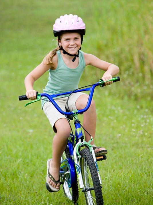 635960585030900780-childonbike.jpg