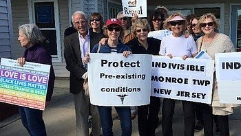 Members of Indivisible of Monroe Township are shown at a rally last year outside the office of U.S. Rep. Chris Smith.