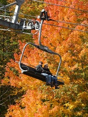 A couple rides the ski lift at the Granite Peak Ski Area at Rib Mountain