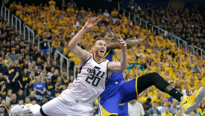 Golden State Warriors forward Kevin Durant, right, fouls Utah Jazz forward Gordon Hayward (20) in the second half during Game 3 of the NBA basketball second-round playoff series Saturday, May 6, 2017, in Salt Lake City. Warriors won 102-91.