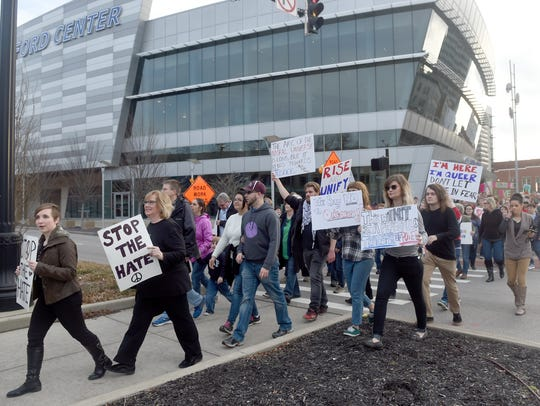 Participants march near the Ford Center during an inauguration