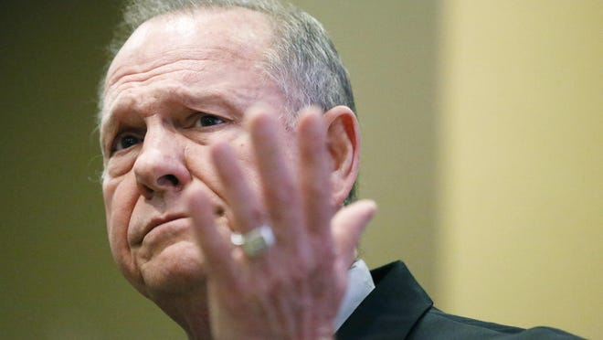 Former Alabama Chief Justice and U.S. Senate candidate Roy Moore speaks at a library in Birmingham, Ala., on Saturday.
