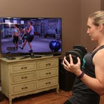 """Loryn Wooten works out at home to """"The Master's Hammer and Chisel"""" DVD by Beachbody."""